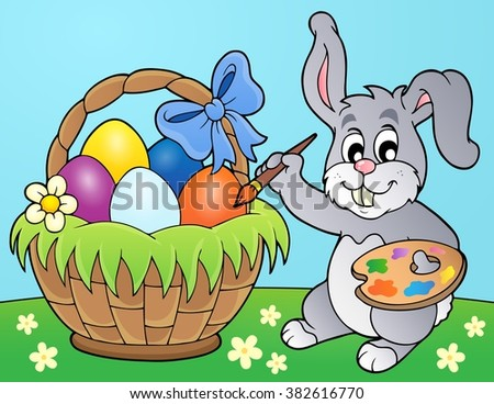 Bunny painting eggs in basket - eps10 vector illustration.