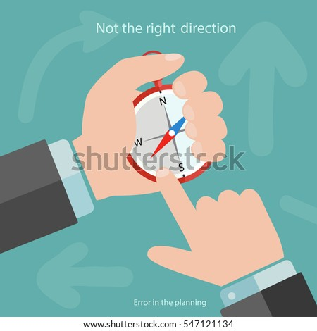 business man hands with compass.the concept of choosing the correct direction in the Affairs of.not the right decision