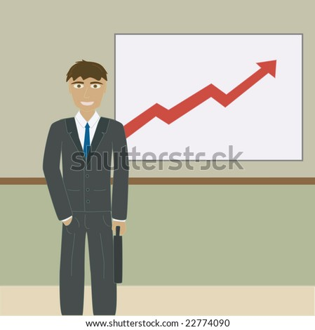 Business man standing in front of chart.
