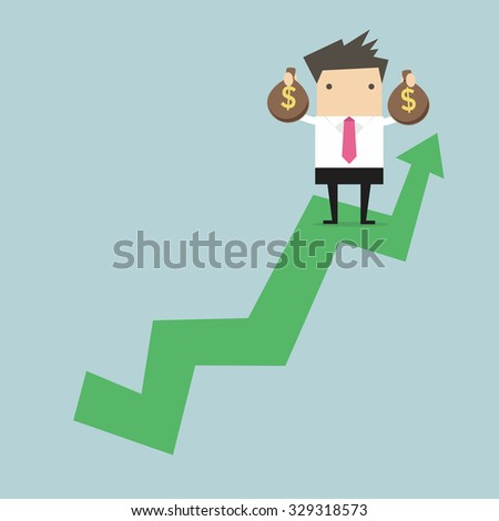 Businessman holding money bag on growing graph.