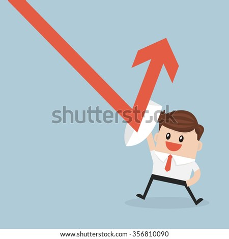 Businessman holding shield prevent from down trend graph to protect his profit.