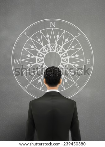 businessman looking at compass over grey background - stock vector