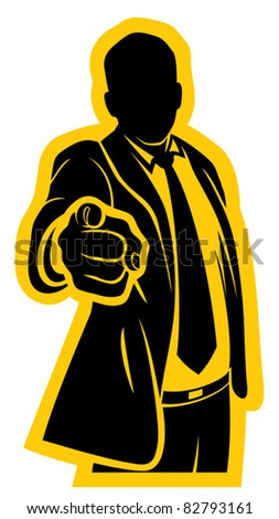 Businessman pointing to the viewer