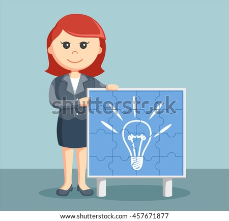 businesswoman with idea puzzle board