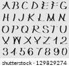 Calligraphic alphabet and numerals - stock vector