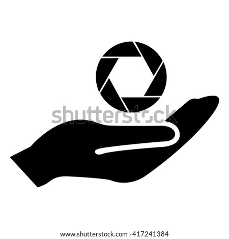 Camera lens icon in hand - stock vector