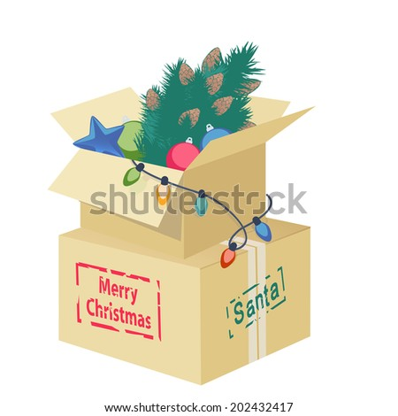 Cardboard box overflowing with Christmas decorations with an eggshell, Christmas tree, ornaments and string of lights with the text - Merry Christmas