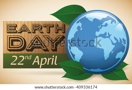 Cardboard reminder of Earth Day celebration with blue planet and leaves.