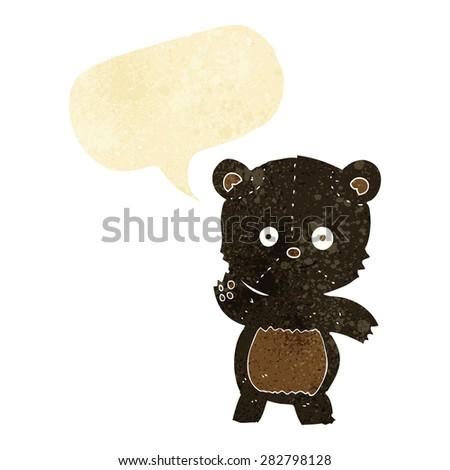 cartoon waving black bear with speech bubble - stock vector