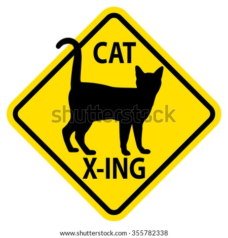 Cat X-ing yield sign featuring a cat.