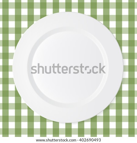 Ceramic circle white plate with green checkered tablecloth