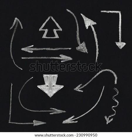 Chalk arrow set on blackboard background - stock vector