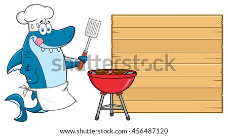 Chef Blue Shark Cartoon Mascot Character Licking His Lips And Holding A Spatula By A Barbeque With Roasted Burgers To Wooden Blank Board. Vector Illustration Isolated On White Background