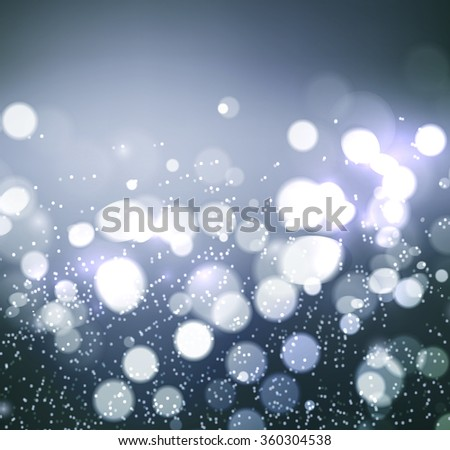 Christmas background. Festive elegant abstract background with silver bokeh  lights  - stock vector