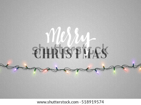 Christmas background with bright realistic garlands. Christmas glowing lights. Xmas Holiday. Greeting cards design Merry Christmas and Happy New Year lettering label.