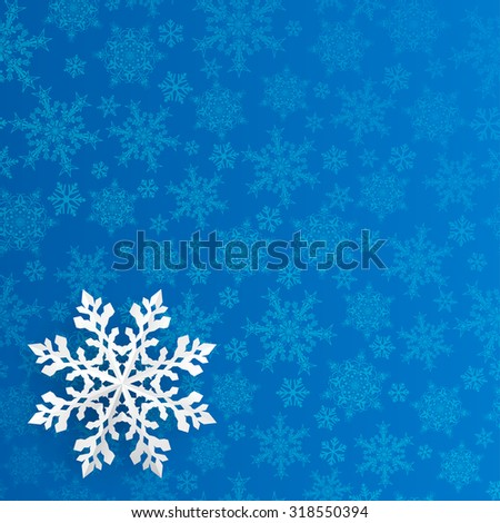 Christmas background with snowflake cut out of paper on blue background of small snowflakes - stock vector