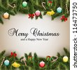 Christmas card with ornaments, Christmas tree branches and candy. Has a light brown background. - stock photo