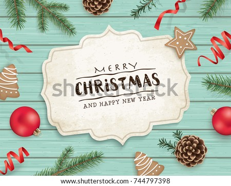 Christmas flat lay design with cookies, ribbons, Christmas ornaments, pine cones, fir branches and greeting card on wooden background