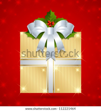 Christmas gift with ribbon and holly wrapped in golden foil
