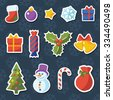 Christmas icons and labels: xmas tree, star, snowflake, bells, ball, snowman, holly, candy, gift; vector set of elements on dark pattern background - stock vector