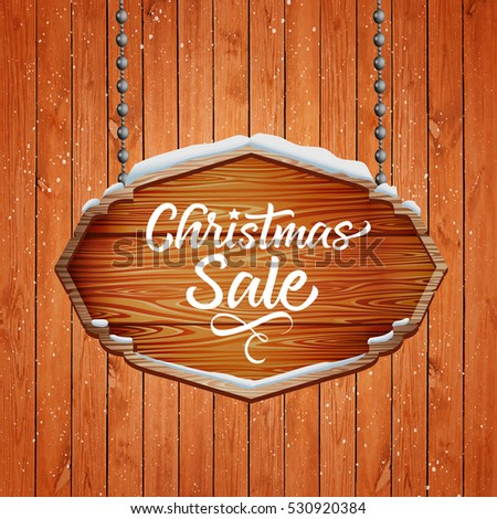 christmas sale. text on a wooden background
