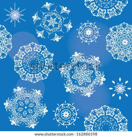 Christmas seamless vector pattern background with shiny snowflakes.