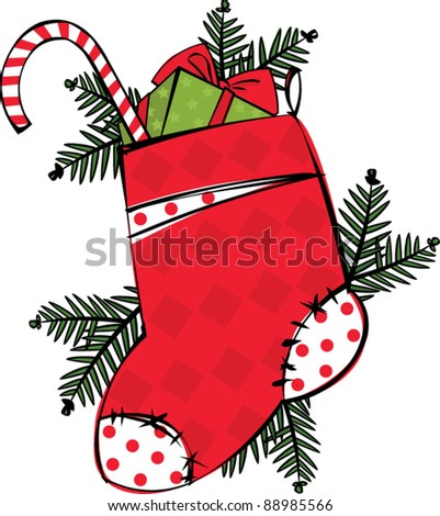 Christmas stocking with gifts and fir branches