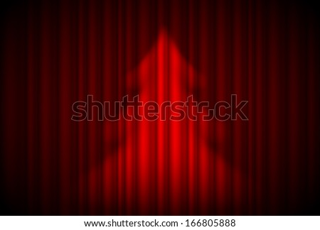 Christmas tree in spotlight on red curtain. Theatre style.