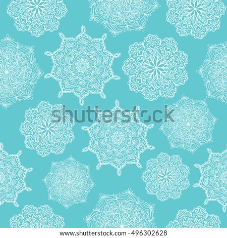 circular patterns white lace snowflake ornament on a blue background