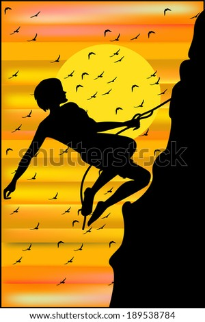 climber on sunset background