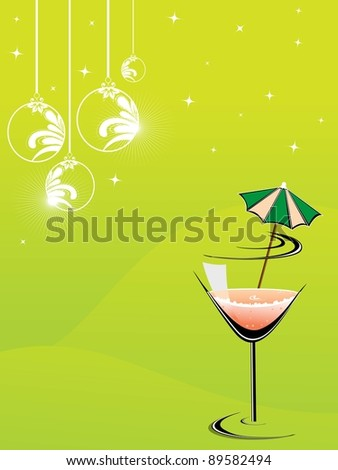 cocktail glass with hanging decorative Christmas balls & shiny stars on yellow color background for party & other occasions.