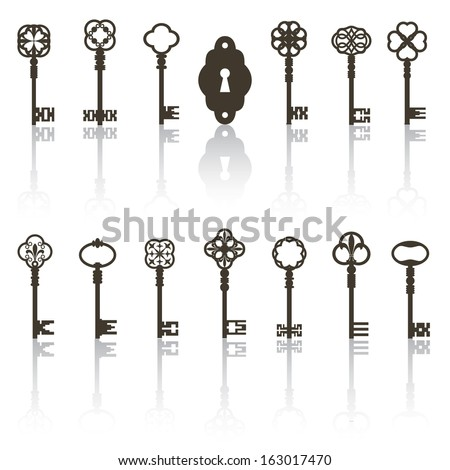 Collection of antique keys, keyhole with shadows. All objects grouped separately.