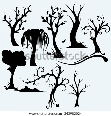 Collection of bare trees. Isolated on blue background. Vector silhouettes - stock vector