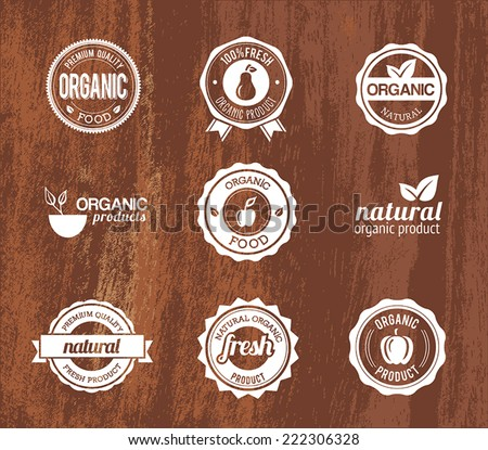 Collection of organic badges on a wooden structure