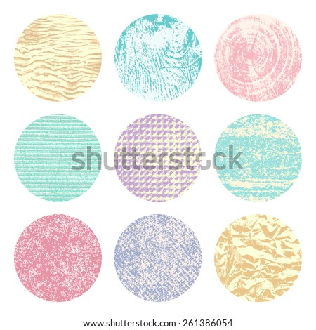 Collection of 9 round pale color vintage background textures of sand, canvas, foil, wood and stone