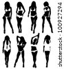Collection of silhouettes of girls in bathing suits - stock photo