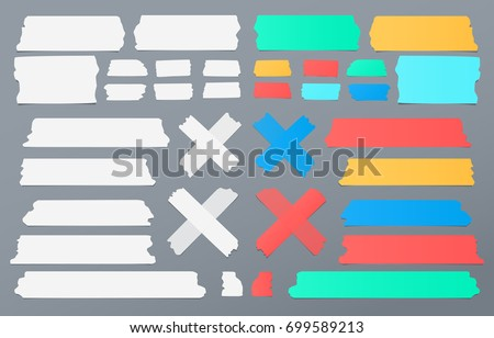 Colorful and white different size adhesive, sticky tape, paper pieces.
