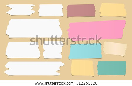 Colorful and white different size sticky, adhesive masking tape are on brown background