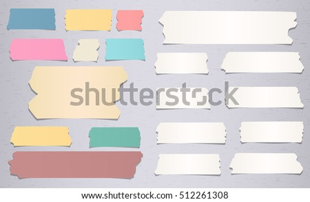 Colorful and white different size sticky, adhesive masking tape are on grey background
