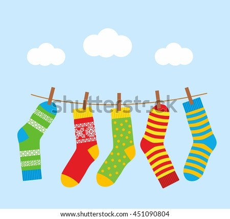 colorful bright socks on a rope with clothespins against a background of sky and clouds. Cute clothes. Cartoon summer illustration.
