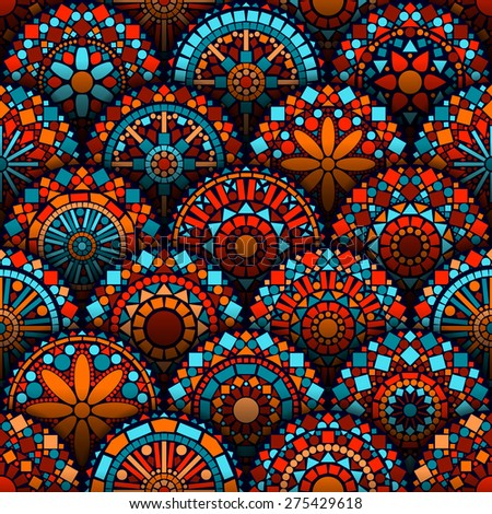 Colorful circle flower mandalas geometric seamless pattern in blue red and orange, vector - stock vector