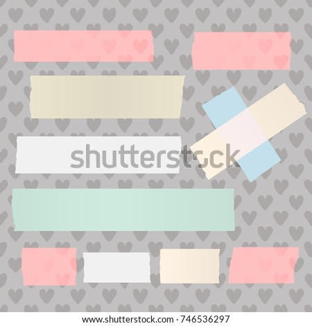Colorful different size adhesive, sticky tape, paper pieces on heart background.