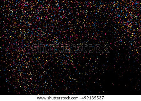 Colorful explosion of confetti. Colored stains and blots. Grainy abstract  colorful texture isolated on black background.  Vector illustration,eps 10.
