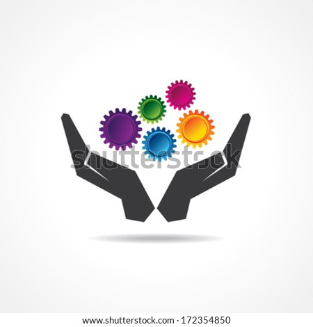 Colorful gears in hand stock vector - stock vector