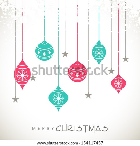 Colorful hanging decorative on grey background for Merry Christmas celebration.