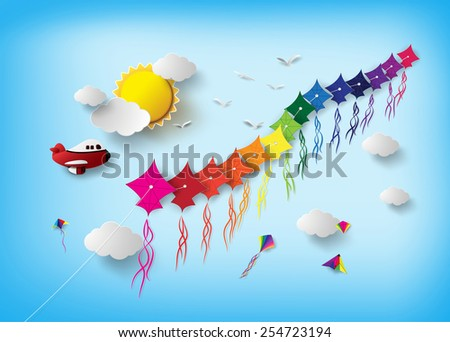 Colorful kite flying on the sky.paper art style.