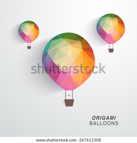 Colorful origami hot air balloon flying on grey background. - stock vector
