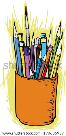 Colorful pencils and brushes in the holder