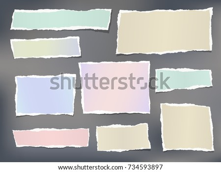 Colorful ripped striped note, copybook, notebook paper stuck on gray background.