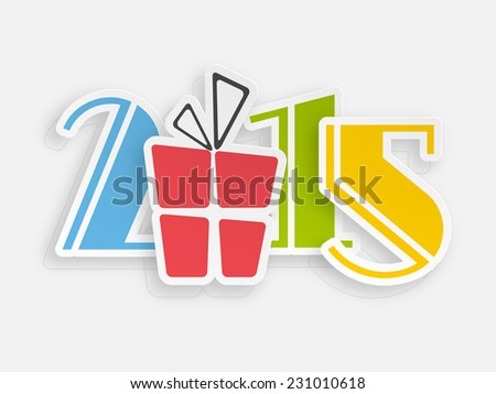 Colorful text with gift box for Happy New Year 2015 celebrations on grey background.